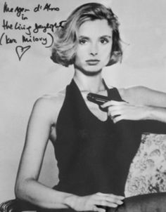 A LARGE 11 X 14 BLACK & WHITE PHOTO SIGNED IN PERSON BY MARYAM D' ABO AS KARA MILOVY FROM THE 1987 JAMES BOND FILM THE LIVING DAYLIGHTS