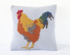 Crochet your own Cockerel Cushion! Inspired by the English countryside and childhood memories, this cushion is great to make with full instructions. Includes colour change chart and photos to guide you through making this delightful cushion. With a buttoned opening on the back to take