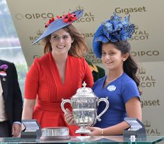 Princess Eugenie presents the trophy to Sheika Al Jalila, daughter of Dubai's Sheikh Mohammed, representing Godolphin after Benbatl wins The Hampton Court Stakes