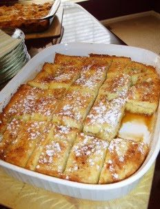 1/2 cup melted butter (1 stick) 1 cup brown sugar 1 loaf Texas toast 4 eggs 1 1/2 cup milk 1 teaspoon vanilla Powdered sugar for sprink...