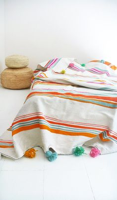 Moroccan POM POM Cotton and Wool Blanket - Sripes Colors  Woven in hand loomed in the souks of marrakech of wool and cotton with hand made pom pom
