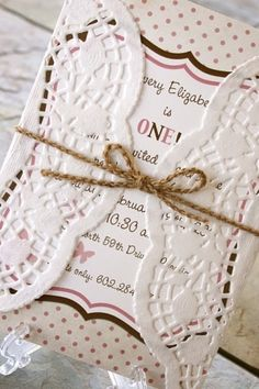 Invitations: Doily invite tied with Bond Twine.. That's a cute (and cheap) little DIY project!!