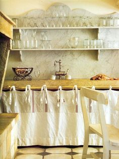 French kitchen-love the marble back splash, shelves, floor tile and counter curtain