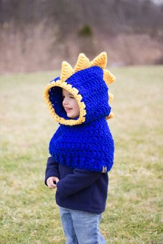 Your little one can have fun and stay warm at the same time with cute Dino Hooded Cowl. Made from soft 100% acrylic yarn which makes it washer and dryer safe. Each item is made to order in the colors of your choice! Please leave color choice in the notes upon check out. Color options are shown in the last product image. If you would like different colors than those shown, please request a custom order.  Sizes: Toddler, Child  Machine washer and dryer safe  Made in a smoke free home  If you…