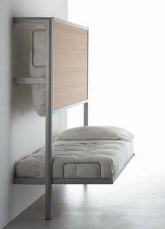 Modern bunk wall bed - would be perfect for a kid's hospital room so that parents could spend the night in a little better comfort then sitting in a chair