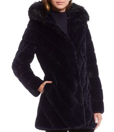 """From Calvin Klein, this coat features:Faux fur fabricationSingle breasted walker silhouetteStand collar with attached faux rabbit fur trimmed hoodLong sleevesGrooved detailSide welt pocketsMid weightStraight hemlineFront clasp closureApprox. 34"""" lengthPolyesterLining: polyesterFaux rabbit fur: polyesterDry cleanImported. Rabbit Fur Coat, Fur Trim, Dillards, Faux Fur, Hoods, Latest Trends, Calvin Klein, Autumn Fashion, Navy"""