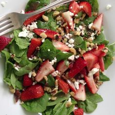 Spinach, strawberries, walnuts, and feta with raspberry vinegarette.  Best summer salad!