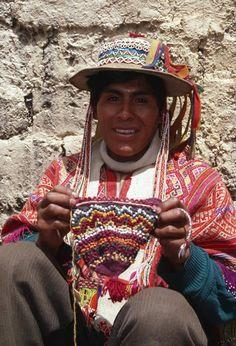 Knitter with popcorn stitch decorated cap in progress, Cuzco area, Peru