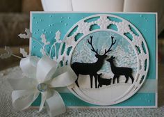handmade card ... die cut winter scene ... black silhouette deer ... gorgeous white  circle with snowflakes ... turquoise base with embossing folder dots ... lovely ...