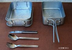 "A set of dixies and a pikstel Dixie: 2 Square aluminium ""plates"" which were kept in your webbing and which were used to eat out of. They fitted inside each other and with the firebucket and pikstel formed your eating kit when in the bush or border"