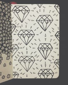 Diamonds. Done with microns in my little red moleskine. :)