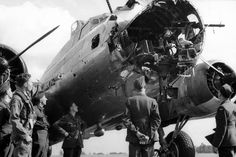 A battle damaged B-17 from the 379th bomb group after a sortie with its nose blown apart shows how much damage the B-17 could take and still make it home.