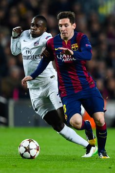 Lionel Messi of FC Barcelona competes for the ball with Blaise Matuidi of Paris Saint-Germain FC during his team's first goal of FC Barcelona during the UEFA Champions League group F match between FC Barcelona and Paris Saint-Germanin FC at Camp Nou Stadium on December 10, 2014 in Barcelona, Catalonia.