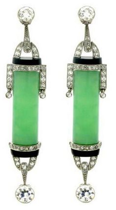 Art Deco Diamond Jade Onyx Earrings circa 1925 A pair of platinum earrings each vertically set with a central barrel shaped green jade the two with an approximate total weight of carats, mounted. Jade Earrings, Jade Jewelry, Art Deco Earrings, Jewelry Art, Antique Jewelry, Vintage Jewelry, Jewelry Design, Drop Earrings, Platinum Earrings