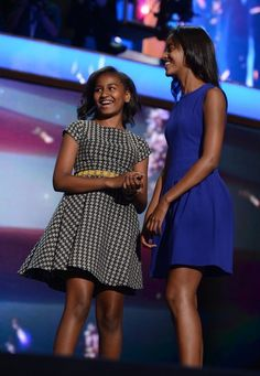 US President Barack Obama's children Malia and Sasha appear on stage after Obama's nomination acceptance speech at the Time Warner Cable Arena in Charlotte, North Carolina, on September 6, 2012 on the final day of the Democratic National Convention....