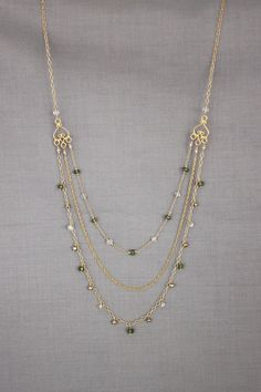 "3 different gold chains; 20.75"" shortest, 25.25"" longest. green apatite; by perseid on Etsy, $170.00:"