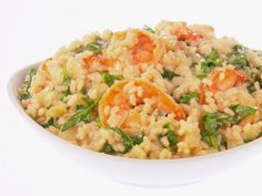 COOK IN USUAL RISOTTO FASHION / ADD ASIAGO CHEESE / GRILL THE SHRIMP AND SERVE ON TOP    Lemony Shrimp and Risotto recipe from Giada De Laurentiis via Food Network