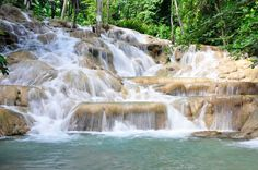 Dunn's River falls one attraction that is definitely a must on a visit to Jamaica! Who can resist such beauty.