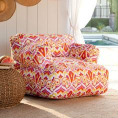 this PBteen chair & woven table would be cute in a pool house