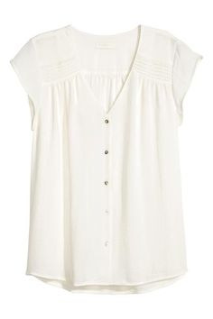 H&M: Short-sleeved blouse: V-neck blouse in an airy crêpe weave with pin-tucks on the shoulders, short cap sleeves and pearly buttons down the front. The blouse is made partly from recycled polyester. V Neck Blouse, Short Sleeve Blouse, Short Sleeve Dresses, Stitch Fix Outfits, Style Board, Denim Cutoffs, Mode Style, Shirt Blouses, Blouse Designs