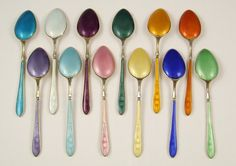 Gorgeous vintage Norwegian sterling silver and guilloche enamel tea/coffee demi-tasse spoon set, consisting of 12 spoons and a pair of tongs, all housed in the original box marketed by Black Starr & Frost, Gorham INC of New York.    Made in Norway by the designer, Aksel Holmsen, whose firm was founded in 1932 in Sandefjord Norway. From The Antique Boutique. www.theantiqueboutique.rubylane.com
