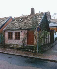1700-talshus i 1800-talsdräkt