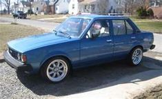 1980 Toyota Corolla. First car I bought with my own money in college.  Mine was Aggie maroon!