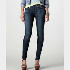 American Eagle Super Stretch Jeggings Size 00R Cotton / elastane  Dark / fade wash Length- 36 Inseam- 29 1/2 Waist flat- 13 1/2 American Eagle Outfitters Jeans Skinny