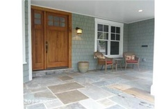 Deep Flagstone Front Porch with custom wide solid front door, sidelight, bead board ceiling with recessed lighting.