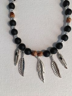 A personal favorite from my Etsy shop https://www.etsy.com/listing/486851744/ghost-beads-and-feathers-boho-southwest