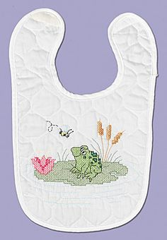 Frog Bib From our Neat and Nifty line, Frog is accented with his own lily pad and flowers while dreaming of things to come!  New velcro closure!    Kit contains: One screen printed 50% polyester/50% cotton prefinished quilted bib,6- strand cotton floss, floss card, needle, graph, instructions.
