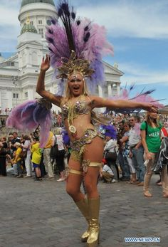 A Samba enthusiast attends Samba carnival parade in Helsinki, capital of Finland, on June 16, 2012. The 22nd Samba carnival was held here on Saturday, attracting nearly 1,000 Samba enthusiasts and teachers and students of Samba schools as well as thousands of locals and foreign tourists. Samba was introduced into Finland in early 1990s and seven Samba schools have been established across the country since then.