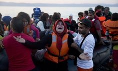 A Syrian refugee disembarks a dinghy after crossing from Turkey to the island of Lesbos, Greece on Saturday.