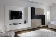 COMPOSICIÓN 18  Composición modular con gran capacidad en la que destaca la modulación en color Negro de un fondo mayor que sobre sale, y totalmente colgada, de 330 cm.