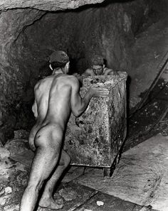 Fulvio Roiter - Miners working in a sulphur mine in Caltanissetta, Sicily. Forced to work naked in the sweltering heat as the clothes stuck to their skin. Solfatara, Sicily, 1953. S)