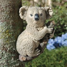 Kouta The Climbing Koala Statue Quantity: Single by Design Toscano. $19.95. Hand-Painted. Design Toscano Exclusive. Cast in Quality Designer Resin. NG34884 Quantity: Single We went out on a limb when engineering this imaginative sculpture to hang from a tree or extend from any garden wall! Our foot-tall Toscano exclusive is realistically sculpted with his own branch to hang onto and the enormous eyes characteristic of Australia's beloved koalas. Kouta is cast in hand-p...