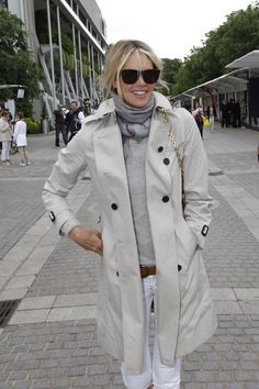 White jeans, tan loafers and belt, light beige sweater with darker beige printed scarf and a beige trench with black buttons - classic
