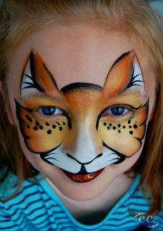 Savannah, Georgia face and body artist Ashlie Alvey of Chubby Cheeks Body Art #savannah #georgia #chubbycheeksart #facepainter #cat #kitty #facepaint