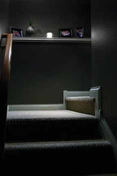 Make Dark Basement Stairs fit in with your home decor.  Add a fresh coat of paint, and create a mantel to display photos.  Add a Wireless LED Stair Light To Easily Light Up Dark Stairs