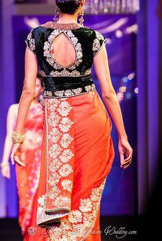 Saree designs.Saree pallu goes inside the blouse...