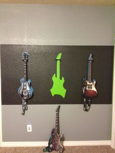 Rock star boys room Paint wall color, paint strip, trace guitars, paint different colors and use lawn hooks to hold up guitars!!