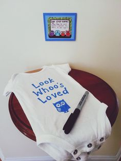 Owl themed baby shower! A great way to show the bouncing baby boy who came to his shower! The guests signed their names front and back. This is something the baby can wear once he's born, or perfect for a shadow box on the wall in the nursery.