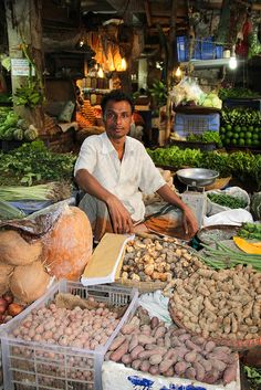 Selling Produce in a Dhaka Market by FeedtheFuture, via Flickr