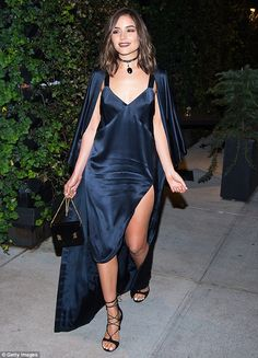 Slinky in satin: Olivia Culpo turned heads once again thanks to her leggy look…