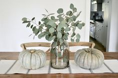 A simple centerpiece of fresh eucalyptus and heirloom pumpkins set the tone for . A simple centerpiece of fresh eucalyptus and heirloom pumpkins set the tone for our informal dining space decor ideas simple 2018 Fall Decorating Ideas decor ideas