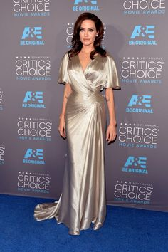Atelier Versace provided Angelina Jolie's silvery wrap-effect dress with fluttery sleeves for the Critic's Choice Awards. (Photo: Alberto E. Rodriguez/Getty Images for A&E Network)