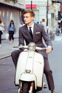 A tailored gray suit, navy tie + white pocket square. Classic menswear fashion at its best.