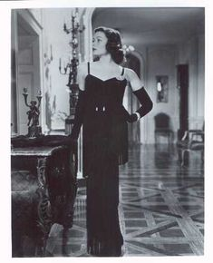 DRESSED BY OLEG CASSINI IN HIS 1946 VIEW OF 1930S FASHION, IN 'THE RAZOR'S EDGE'