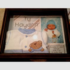 Ty's newborn shadow box. Backed in scrapbook paper, used Cricut for his name, and printed birth stats on computer.