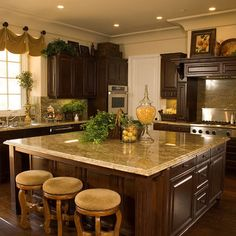 Tuscan Kitchen Decor, i like the counter top with these chocolate cabinets. and the lighter stools and walls help brighten the room